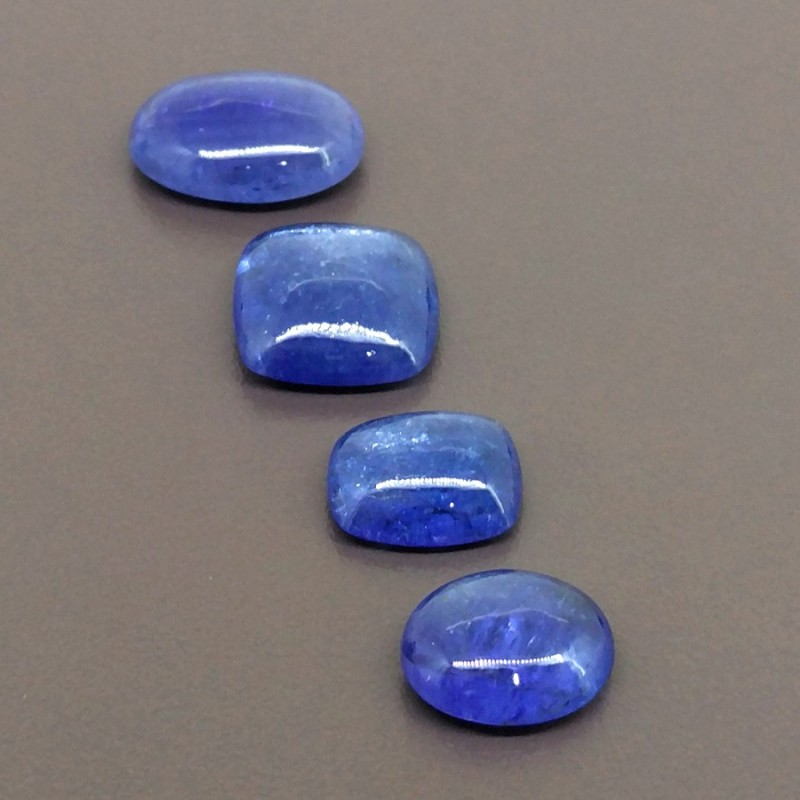 49.25 Cts. Tanzanite 8.60-17.25mm Smooth Mixed Shapes Shape Cabochon Parcel (4 Pcs.)
