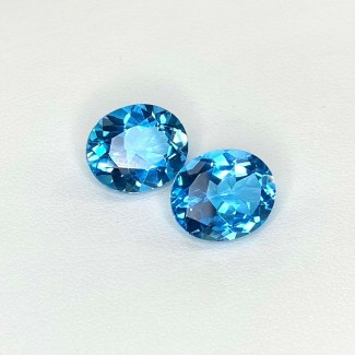 11.59 Cts. Swiss-Blue Topaz 12x10mm Regular Cut Oval Shape Matched Gems Pair - Total 2 Pcs. - SKU:158356
