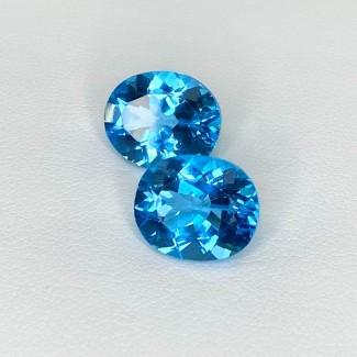 11.66 Cts. Swiss-Blue Topaz 12x10mm Regular Cut Oval Shape Matched Gems Pair - Total 2 Pcs. - SKU:158353