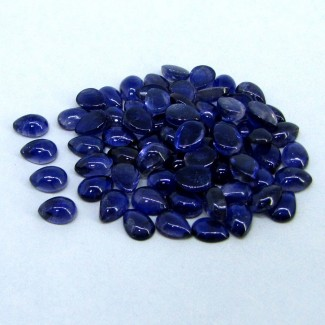 65.1 Cts. Iolite 7x5mm Pear Shape Cabochon Parcel (90 Pcs.)