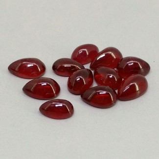 13.70 Cts. Ruby 7x4-8x5mm Smooth Pear Shape Cabochon Parcel (11 Pcs.)