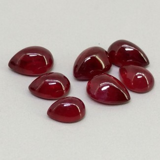 15.55 Cts. Ruby 7x5-9x7mm Smooth Pear Shape Cabochon Parcel (7 Pcs.)